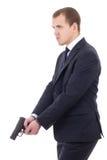 Policjant lub ochroniarz w garniturze z pistoletem odizolowywającym na whi obraz stock