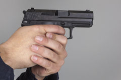 Policjant z pistoletem Obrazy Royalty Free