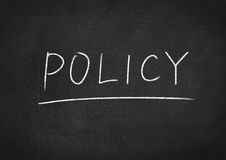 Policy. Concept word on blackboard background Stock Photos