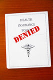 Policy denied. A health insurance policy, with Denied stamp Royalty Free Stock Images