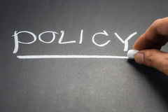 Policy. Hand writing Policy topic on chalkboard Stock Photography