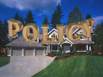 POLICY - inscription of bright gold letters on garden Royalty Free Stock Photography