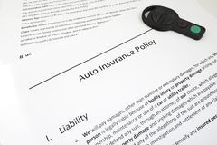Policy and key. Closeup of auto insurance policy with car key Stock Photos