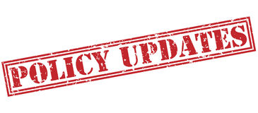 Policy updates red stamp Stock Images