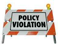 Policy Violation Warning Danger Sign Non Compliance Rules Regula. Policy Violation words on a road construction barrier or sign warning you of a rule or Stock Photography