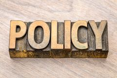 Policy word abstract in wood type Royalty Free Stock Photos