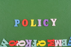 POLICY word on green background composed from colorful abc alphabet block wooden letters, copy space for ad text Stock Image
