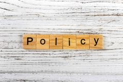 Policy word made with wooden blocks concept Royalty Free Stock Photos