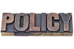 Policy word in wood type Stock Photo