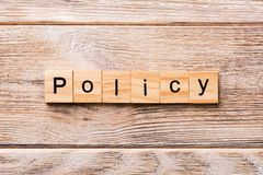 Policy word written on wood block. Policy text on wooden table for your desing, concept stock photo