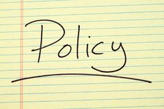 Policy On A Yellow Legal Pad. The word `Policy` underlined on a yellow legal pad Royalty Free Stock Photos