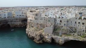 Polignano a Mare Bari, Italy: heaven on earth. Coastal and caves aerial 4k drone footage video above sea Stock Images