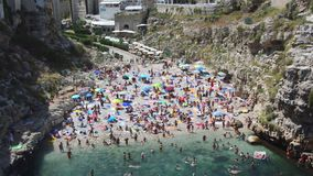 Polignano A Mare, Italy - August 4, 2017: aerial view of Polignano a mare beach and cliffs, Apulia, southern Italy.  stock video footage