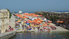 Polignano A Mare, Italy - August 4, 2017: small beach with umbrellas and chairs, Apulia, Italy.  stock footage