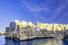 Polignano a Mare, Puglia, Italy. Sunset at Cala Paura gulf with and Lama Monachile, Apulia, Italy, province of Bari beach southern sea landscape village stock image