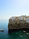 Polignano a mare village on cliff rocks and Mediterranean sea. Overhanging buildings in Apulia town on sea. Italian seascape. Stock Image