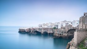 Polignano a Mare village foggy sunrise, Bari, Apulia, Italy. Polignano a Mare village on the rocks foggy sunrise, Bari, Apulia, southern Italy. Europe stock image