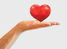 Poligonalnej lewej ręki palmowego serca miłości niska poli- ujawniona płaska dolina Fotografia Stock