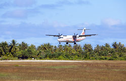 POLINESIA- JUNE 16:  plane - ATR 72 Air Tahiti companies makes landing on the small tropical island Tikehau on june 16, 2011 Stock Image