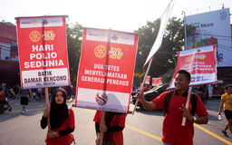 Polio day. Activists are conducting action while commemorating the world polio day in the city of Solo, Central Java, Indonesia Royalty Free Stock Images