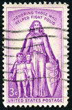 Polio US Postage Stamp. UNITED STATES OF AMERICA - CIRCA 1957: A used postage stamp from the USA, honoring those who have helped fight Polio, circa 1957 Royalty Free Stock Photo