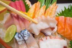 Polipo in bastoncini con l'insieme giapponese del sashimi Fotografie Stock