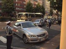 Polis de tráfico de la organización Japón Foto de archivo