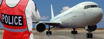 polis för flygplanflygplatsframdel Arkivfoto