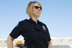 Polis Wearing Sunglasses Arkivfoto