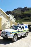 Polisbil på kontroll för Sani passerandegräns mellan Sydafrika och Lesotho Arkivbild