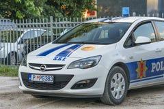 Polisbil på parkeringen Arkivfoto
