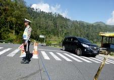 Polisen som blockerar vägen Royaltyfri Fotografi