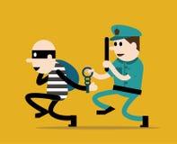 Polisen som försöker att fånga en brottsling Royaltyfri Bild
