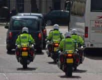 Poliseskort Royaltyfria Bilder