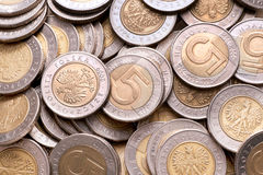 Polish 5 pln coins background. Polish currency 5 pln (zloty) coins background royalty free stock images