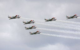 The Polish Air Force Orlik Aerobatics Team flying over cloudy sk Royalty Free Stock Image
