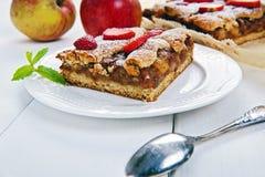 Polish apple pie with fresh strawberries on white table Royalty Free Stock Photos