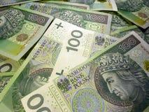 Polish banknotes background. Money background with stacked many Polish 100 ZL banknotes stock photography