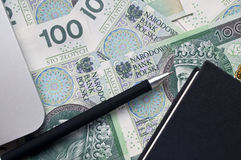 Polish banknotes and note. Laptop near polish banknotes and note Stock Images