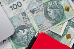 Polish banknotes, pen and note. Polish banknotes on the desk near laptop Royalty Free Stock Photo