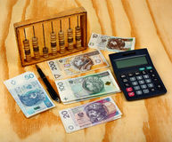 Polish calculation tax. Polish money, calculator, pen, wallet and abacus royalty free stock photo
