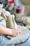 Polish of a ceramic vase Stock Photos