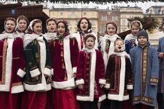 Polish children in traditional clothing singing Christmas songs. DECEMBER 24, 2017 - KRAKOW, POLAND:   Polish children dressed in traditional costume singing Stock Photo