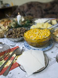 Polish Christmas table. A table set with some typically Polish dishes. All vegetarian foods. A decorative seasonal composition with a candle. Some pieces of holy Stock Photo