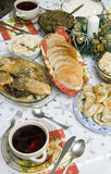 Polish Christmas table. A table set with some typically Polish dishes. All vegetarian foods. A decorative seasonal composition with a candle. (Barszcz czerwony z Stock Photos