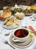 Polish Christmas table. A table set with some typically Polish dishes. All vegetarian foods. A decorative seasonal composition with a candle. (Barszcz czerwony z Royalty Free Stock Image