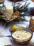 Polish Christmas table. A table set with some typically Polish dishes. All vegetarian foods. A decorative seasonal composition with a candle Royalty Free Stock Photo