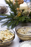 Polish Christmas table. A table set with some typically Polish dishes. All vegetarian foods. A decorative seasonal composition with a candle Stock Photography