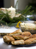 Polish Christmas table. A table set with some typically Polish dishes. All vegetarian foods. A decorative seasonal composition with a candle. Plate of croquettes Stock Photos
