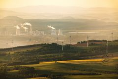Coal and Wind energy. Polish coal power station Turow and wind power plants Stock Photo